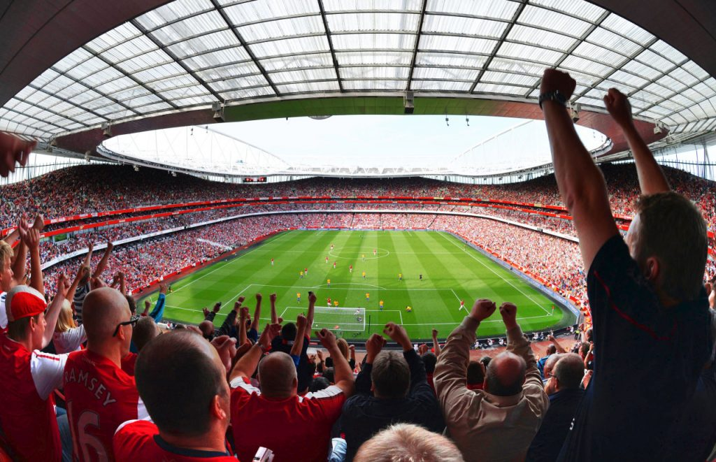 LONDON, ENGLAND - SEPTEMBER 15: Fans of Arsenal celebrate the 4th Arsenal goal of the match during the Barclays Premier League match between Arsenal and Southampton at Emirates Stadium on September 15, 2012 in London, England. (Photo by Mike King - Arsenal FC /Arsenal FC via Getty Images)