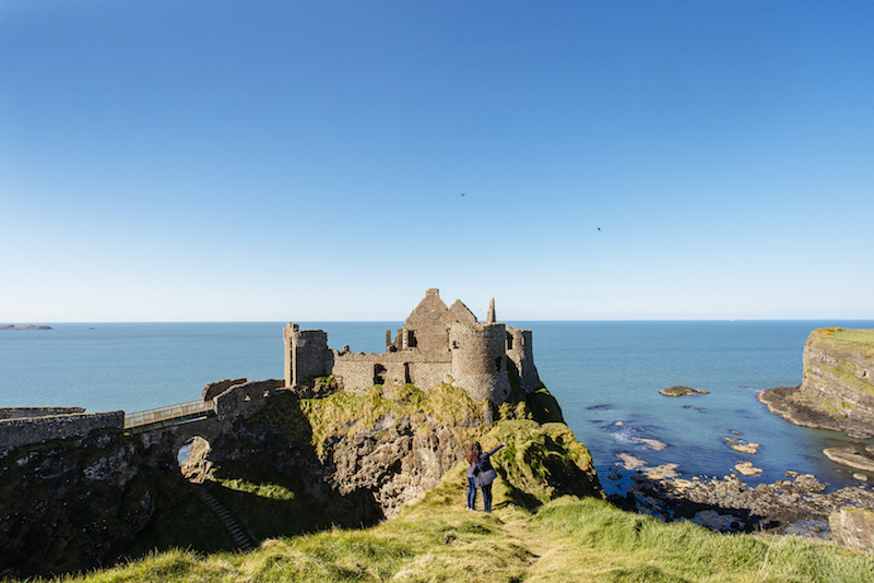Visitors enjoying a day out at Dunluce Castle, County Antrim, Northern Ireland.